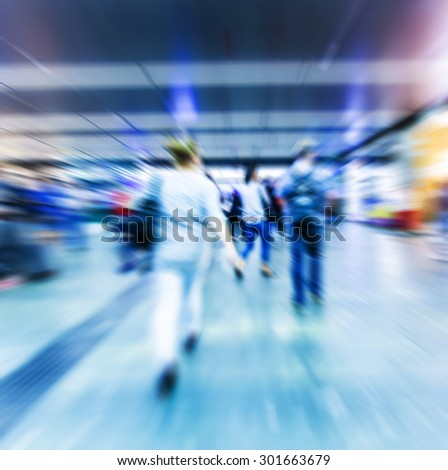 Motion blurred people walking in subway station.abstract city people background