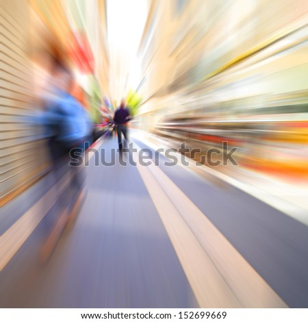 Motion blurred people walking in the city. - stock photo