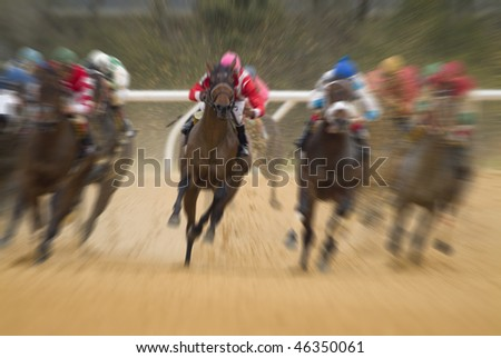 Motion blurred race horse action - stock photo