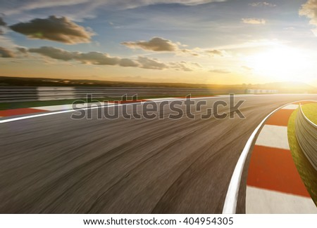 Motion blurred racetrack,sunrise mood - stock photo