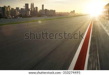 Motion blurred racetrack,warm mood - stock photo