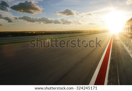 Motion blurred racetrack,warm mood - stock photo