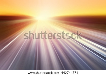 Motion blurred road during sunset. - stock photo