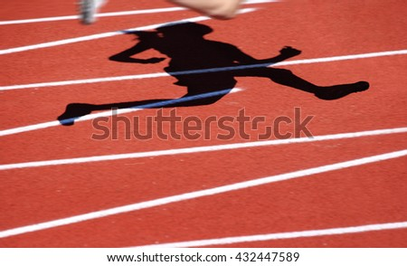 Motion blurred runners shadow, track and field race - stock photo