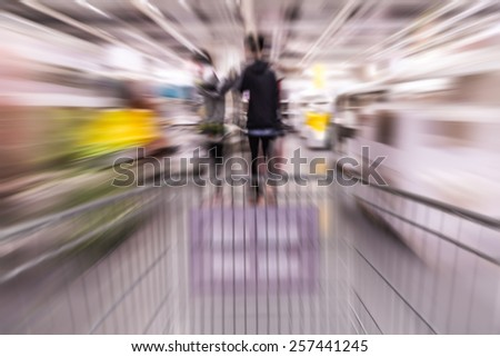 Motion blurred shopping inside store - stock photo