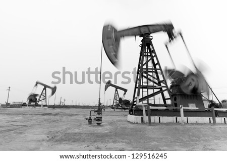 Motion blurred steel oil pumps - stock photo