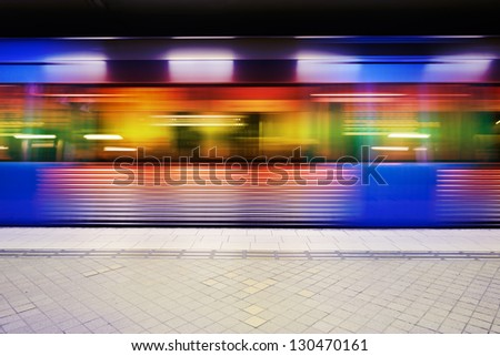 Motion blurred subway train - stock photo