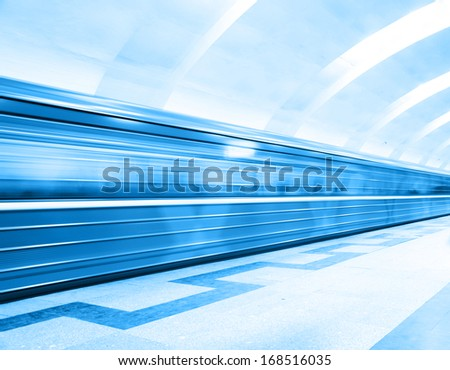 Motion blurred subway train at the station. - stock photo