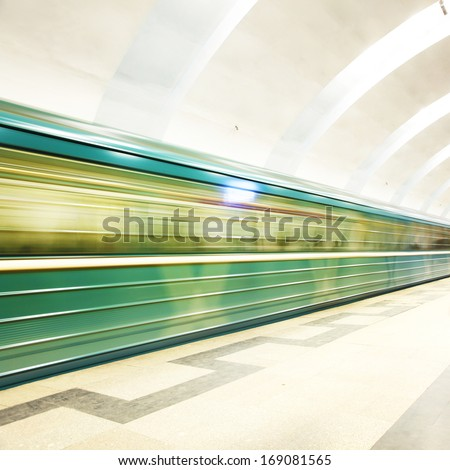 Motion blurred subway train at the station.