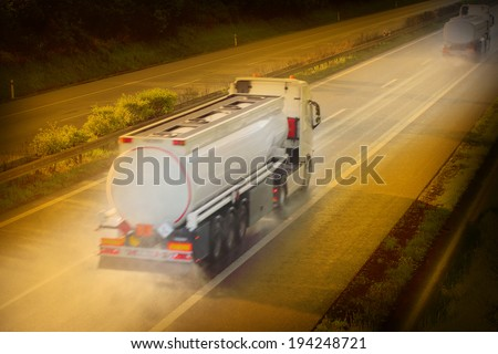 Motion blurred tanker truck on the highway. Chemical industry and pollution concept. - stock photo