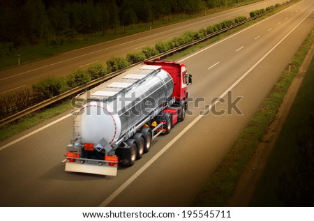 Motion blurred tanker truck on the highway. Industry and pollution concept.  - stock photo