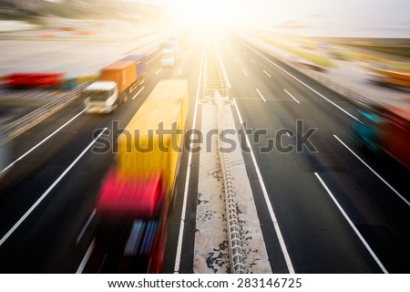 motion blurred truck on a highway/motorway/speedway - stock photo