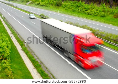 Motion blurred truck on highway. Transportation industry metaphor - stock photo