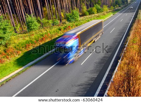 Motion blurred trucks on highway. Transportation industry metaphor - stock photo