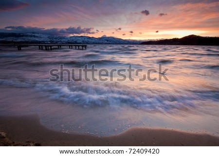 Motion Blurred Waves Reaching Shore - stock photo