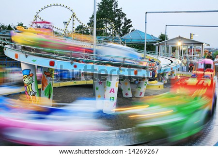 motion car in amusement park - stock photo