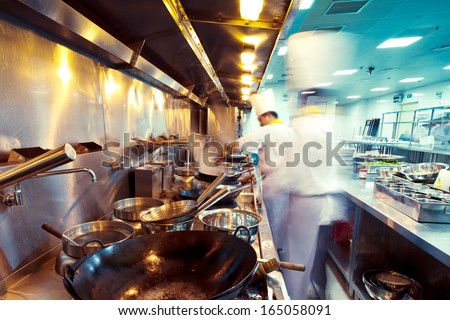 motion chefs of a restaurant kitchen - stock photo