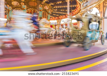 motion of Carousel Horse for children in amusement park. - stock photo