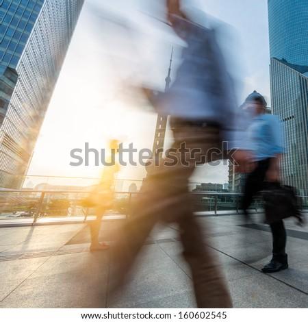 motion passengers walking on the landmark of shanghai china background. - stock photo