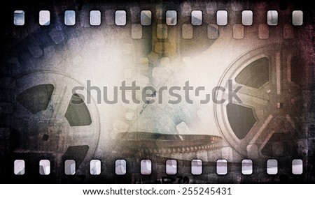 Motion picture film reel with photostrip - stock photo
