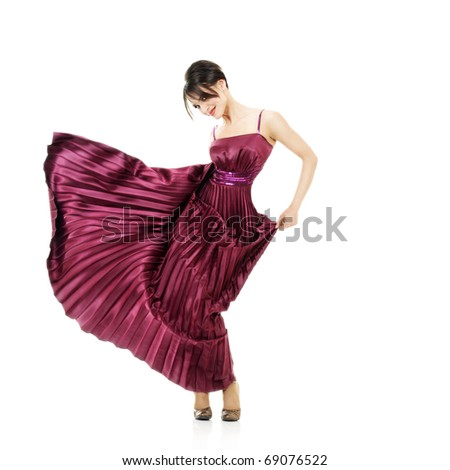 Motion sexy woman with flying dress isolated over white background - stock photo