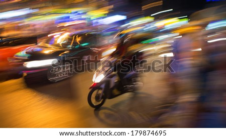 Motion Thai night street, motobike - stock photo
