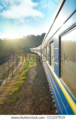 Motion train and blue wagon. Urban transportation - stock photo