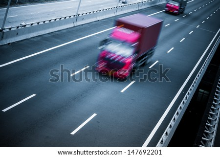 motion trucks on the freeway. - stock photo