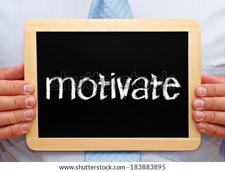 motivate - businessman with chalkboard - stock photo