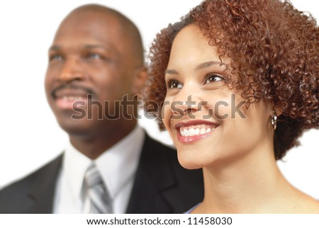 Motivated and energetic business portrait with a happy, beautiful woman in front - stock photo