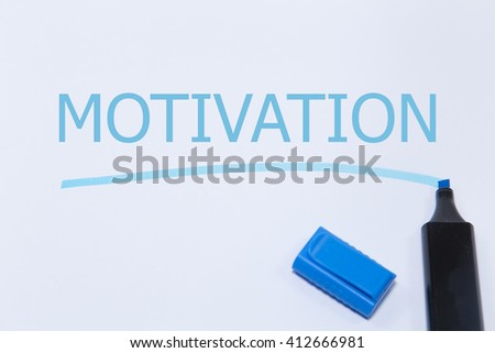 motivation in text on a green sticky note posted to a cork notice board.