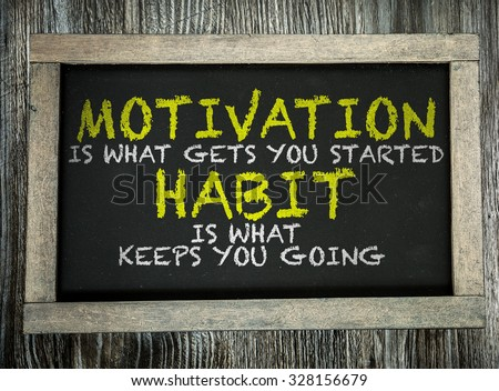 Motivation is What Gets You Started Habit Is What Keeps You Going written on chalkboard - stock photo