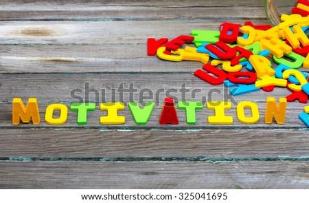 Motivation text on wood background - stock photo