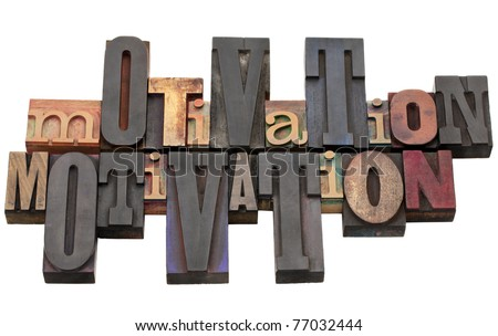 motivation word abstract - antique wood letterpress printing blocks of different size and style isolated on white