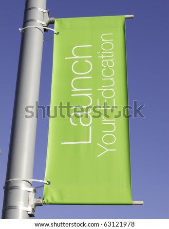 Motivational banner on campus of community college: Launch Your Education - stock photo