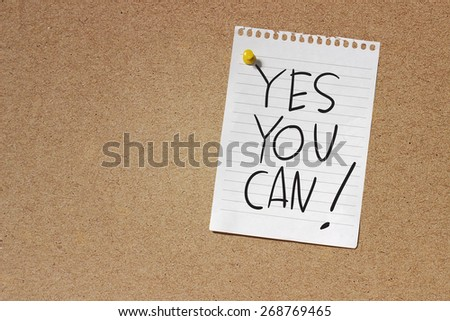 Motivational Concept Image of message note paper pinned on cork board with Yes You Can words written on it - stock photo