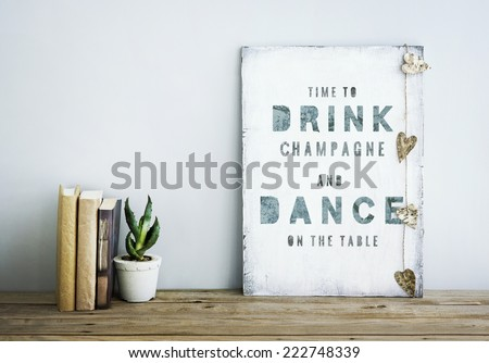 motivational inspirational poster quoteTIME TO DRINK champagne AND DANCE ON THE TABLE Room decoration american or scandinavian style  with books, succulent in the pot and heart shaped garland. - stock photo