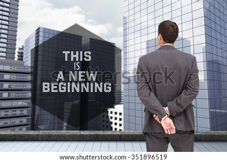 Motivational new years message against businessman standing with hands behind back - stock photo