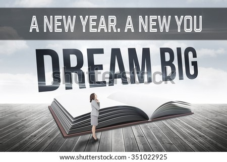 Motivational new years message against dream big against open book against sky - stock photo
