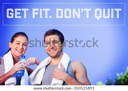 Motivational new years message against happy sporty couple - stock photo