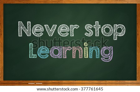 """Motivational quote """"Never Stop Learning"""" written on chalkboard - stock photo"""