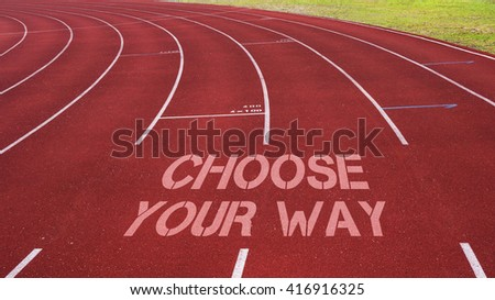 Motivational quote written on running track : Choose Your Way - stock photo