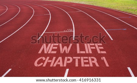 Motivational quote written on running track : New Life Chapter 1 - stock photo