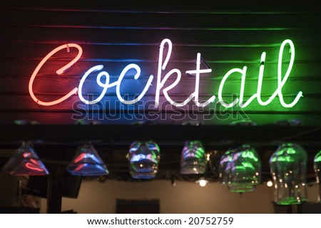 """motley """"cocktail"""" inscription on the wall of cafe. Focus on inscription - stock photo"""