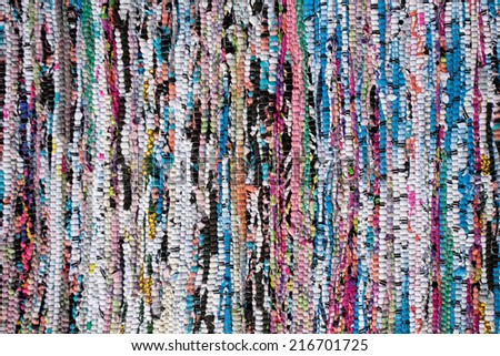 motley rug  textile fabrics texture in Scandinavian village style closeup - stock photo