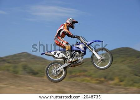 Moto Cross high jump - stock photo