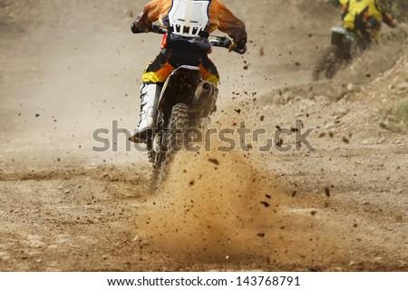 motocross bike increase speed in track - stock photo