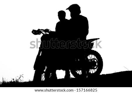 motocross biker silhouette during the sunset - stock photo