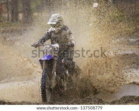 Motocross race on wet and muddy terrain in Parola, Finland - stock photo