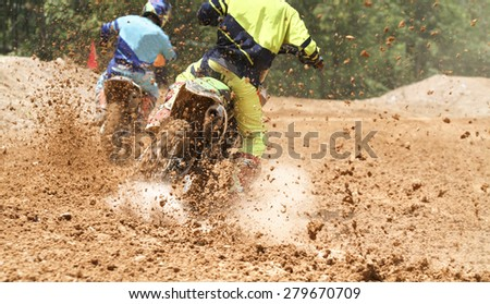 motocross racer accelerating speed in track